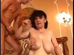 Milf in black pantyhose takes two dicks