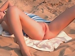 Teenager showing pink on the beach