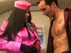 Stewardess in satin sucking on cock