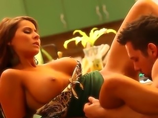 Madison Ivy is having a good time on a kitchen table, while her bf is licking...