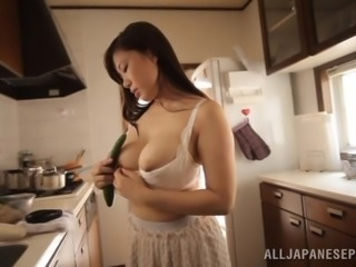 Eri Hosaka fingers her Japanese pussy in the kitchen