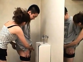 Yuma Asami in a public bathroom with a horny young lad