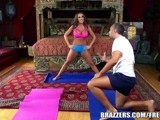 Yoga teacher Richelle Ryan relaxes her student