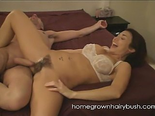 Homegronwhairybush Tara is bathing herself. Her tits are exposed and she...