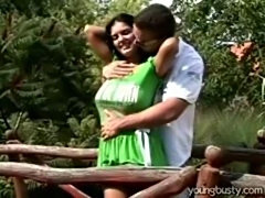 A very busty teenage chick fucking boyfriend in the garden